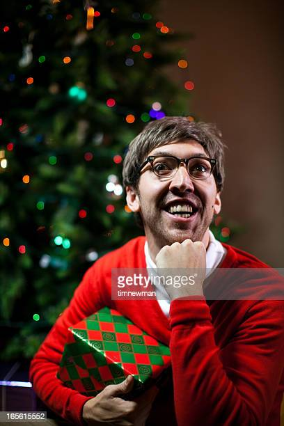 Nerdy Christmas Man Holding Gift Close