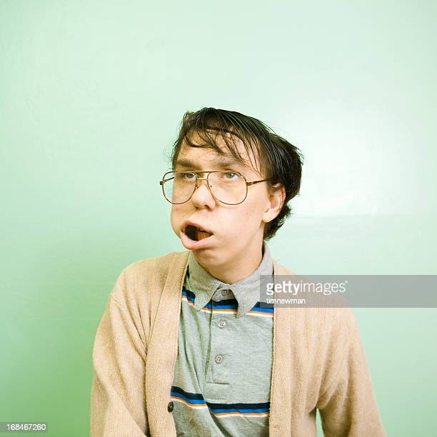 nerdy dude with wild facial expression - ugly face stock photos and pictures