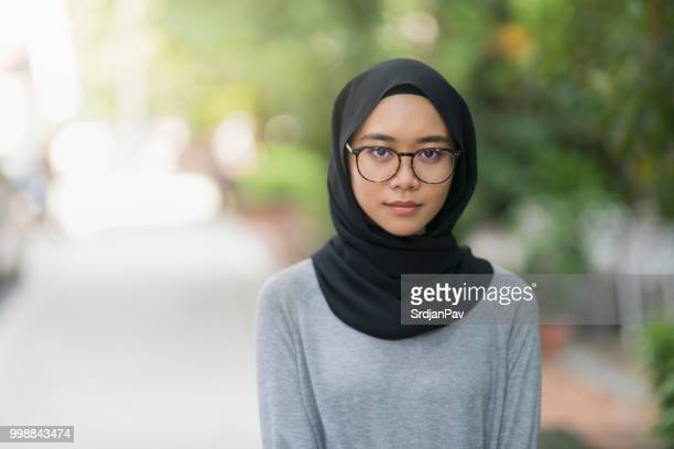 nerdy girl from the east - malaysia beautiful girl stock photos and pictures