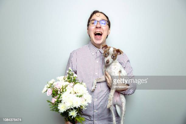 nerdy guy and lap dog - ugly dog stock photos and pictures