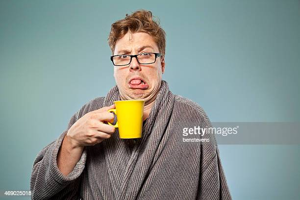 Nerdy guy drinking bad coffee