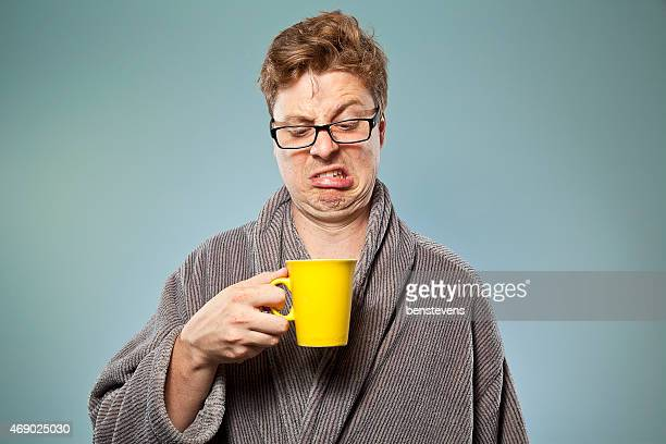 Nerdy guy drinking bad coffee