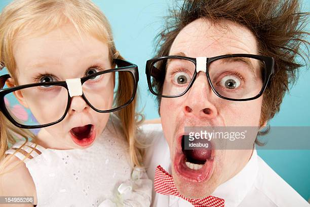 nerdy man and little girl gasping with look of surprise - crazy dad stock photos and pictures