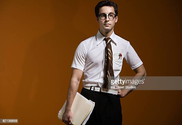 nerdy man holding school books - nerd stock pictures, royalty-free photos & images