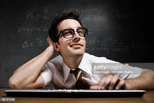 nerdy man in front of blackboard - nerd stock pictures, royalty-free photos & images