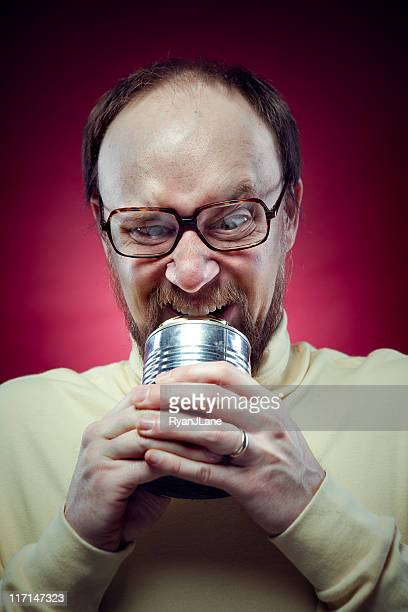 Nerdy Man Opening Can with Teeth