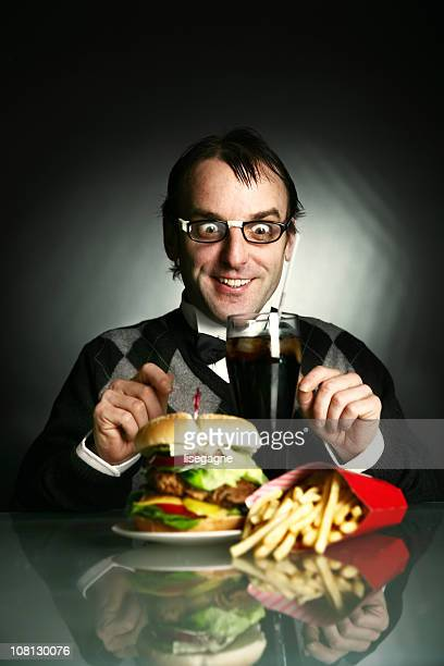 Nerdy Man Sitting in Front of Burger Dinner
