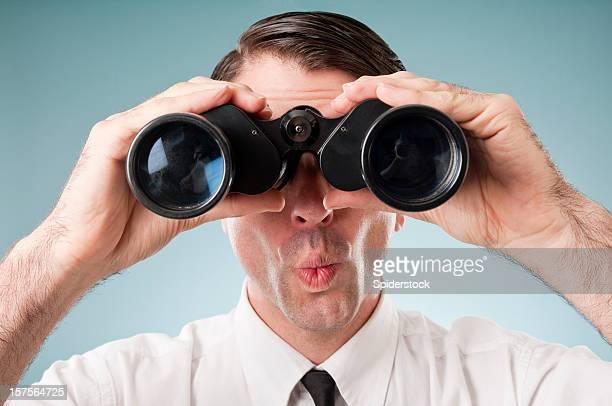 Nerdy Office Worker With Binoculars