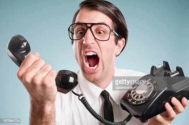 nerdy office worker with vintage telephone - negative emotion stock pictures, royalty-free photos & images