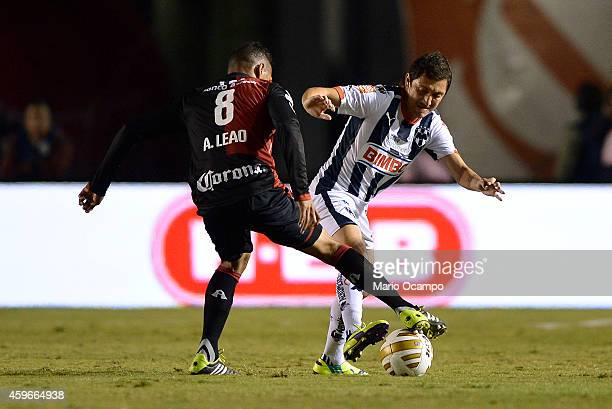 Neri Cardozo of Monterrey fights for the ball with Aldo Leao of Atlas during a quarterfinal first leg match between Monterrey and Atlas as part of...