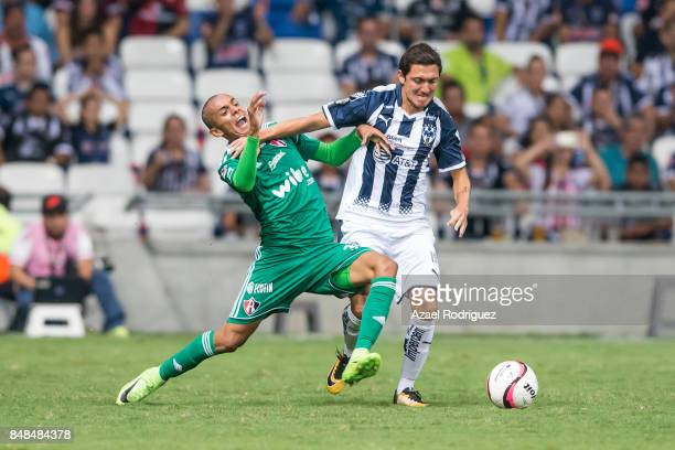Neri Cardozo of Monterrey fights for the ball with Ulises Cardona of Atlas during the 9th round match between Monterrey and Atlas as part of the...