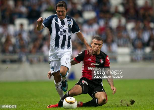 Neri Cardozo of Monterrey vies for the ball with Christian Tabo of Atlas during their quarter final Mexican Apertura 2017 tournament football match...