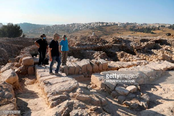 Neria Sapir and Benjamin Storchan , archaeologists with the Israel Antiquities Authority, tour an excavation site, dating back to the Kingdom of...