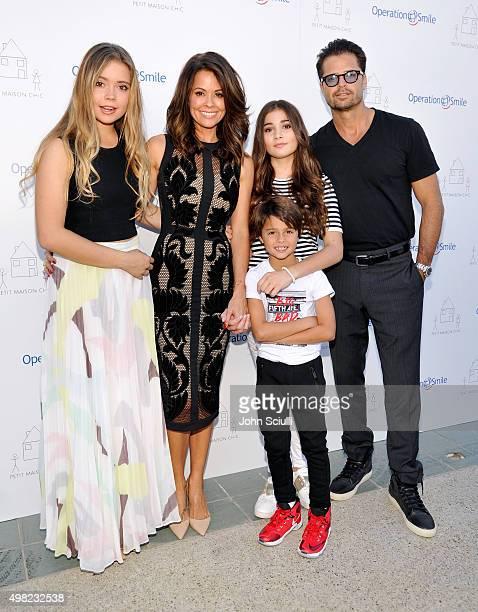 Neriah Fisher actress Brooke BurkeCharvet Shaya Charvet Sierra Fisher and actor David Charvet attend the Petit Maison Chic fashion show honoring...