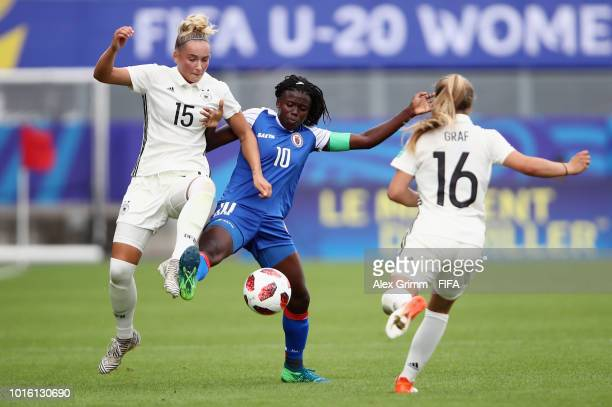 Nerilia Mondesir of Haiti is challenged by Nina Lange of Germany during the FIFA U20 Women's World Cup France 2018 group D match between Germany and...