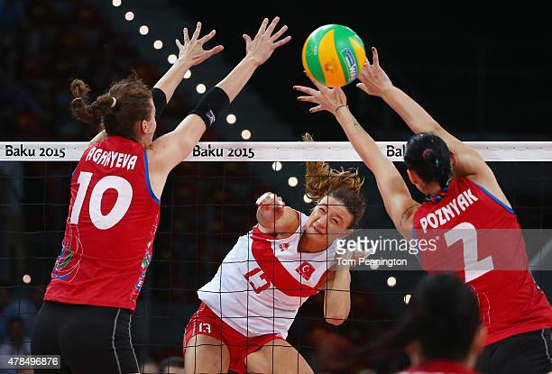 Neriman Ozsoy of Turkey spikes the ball against Jana MatiasovskaAghayeva of Azerbaijan and Kseniya Poznyak of Azerbaijan during the Women's...