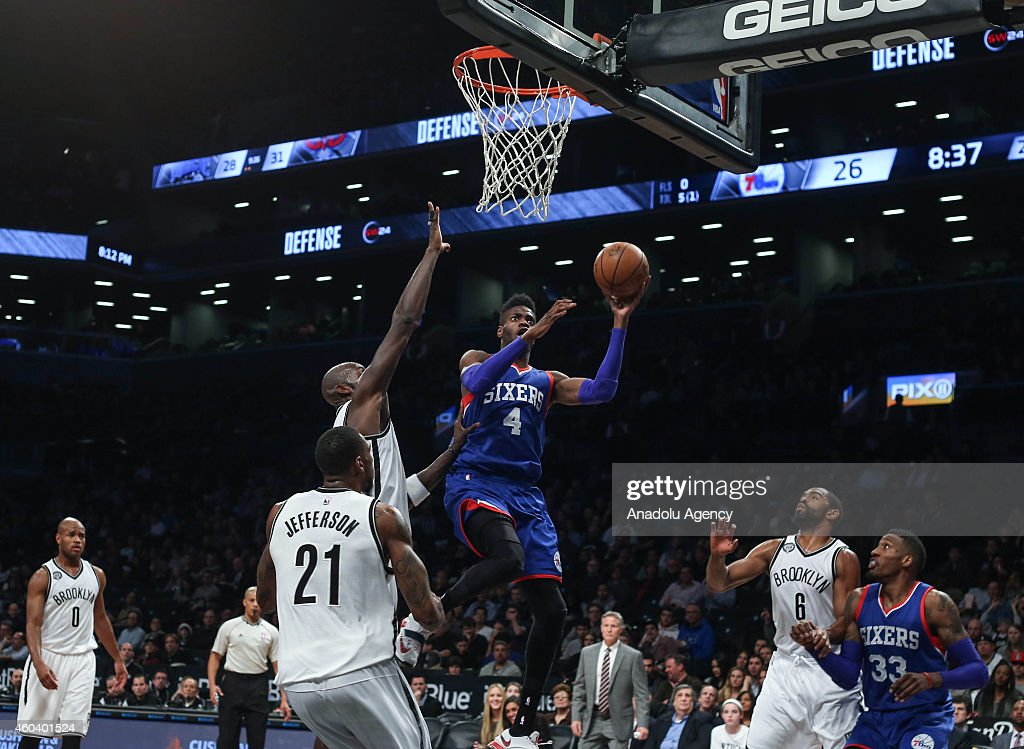 Nerlens Noel #4 and Robert Covington #33 of Philadelphia 76ers vies with Kevin Garnett #2, Cory Jefferson #21 and Alan Anderson #6 of Brooklyn Nets during a basketball game at the Barclays Center on December 12, 2014 in the Brooklyn borough of New York, NY.
