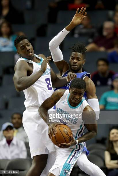 Nerlens Noel of the Dallas Mavericks tries to stop teammates Johnny O'Bryant III and Dwayne Bacon of the Charlotte Hornets during their game at...