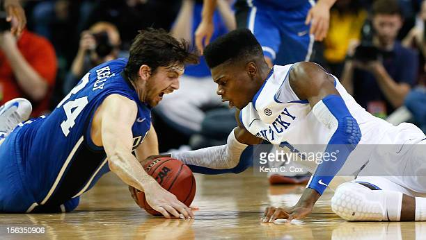 Nerlens Noel of the Kentucky Wildcats and Ryan Kelly of the Duke Blue Devils battle for a loose ball during the 2012 State Farm Champions Classic at...