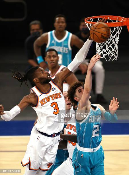 Nerlens Noel of the New York Knicks blocks a shot from LaMelo Ball of the Charlotte Hornets in the third quarter at Madison Square Garden on May 15,...
