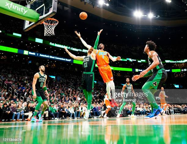 Nerlens Noel of the Oklahoma City Thunder and Enes Kanter of the Boston Celtics compete for a rebound during the first quarter of the game at TD...