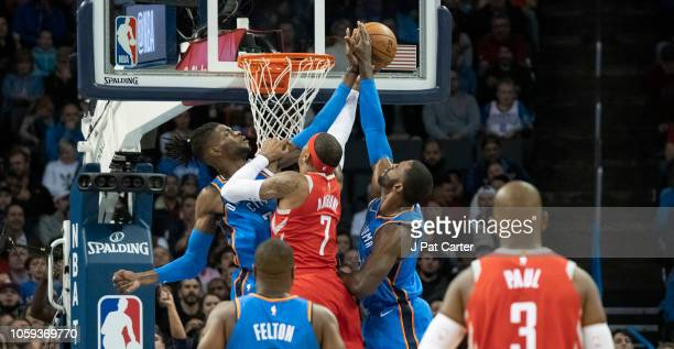 Nerlens Noel of the Oklahoma City Thunder and Patrick Patterson of the Oklahoma City Thunder block Carmelo Anthony of the Houston Rockets as he tries...