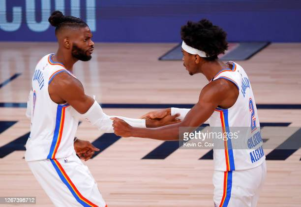 Nerlens Noel of the Oklahoma City Thunder and Shai Gilgeous-Alexander of the Oklahoma City Thunder react to a shot during the third quarter against...