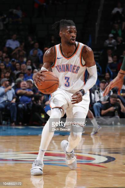 Nerlens Noel of the Oklahoma City Thunder handles the ball against the Milwaukee Bucks during a preseason game on October 9 2018 at Chesapeake Energy...