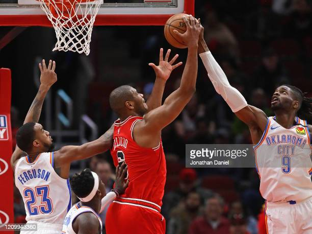 Nerlens Noel of the Oklahoma City Thunder knocks a rebound away from Cristiano Felicio of the Chicago Bulls at the United Center on February 25, 2020...