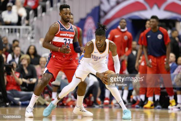 Nerlens Noel of the Oklahoma City Thunder looks to pass against Jeff Green of the Washington Wizards during the second half at Capital One Arena on...