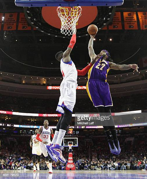 Nerlens Noel of the Philadelphia 76ers fouls Jordan Hill of the Los Angeles Lakers as he attempts to dunk the ball on March 30 2015 at the Wells...