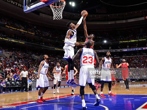 Nerlens Noel of the Philadelphia 76ers makes a huge block against Tony Snell of the Chicago Bulls at the Wells Fargo Center on March 11 2015 in...