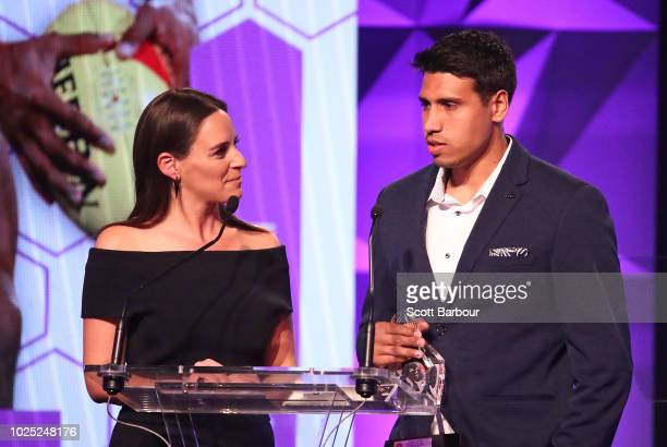 Neroli Meadows speaks to Tim Kelly of the Cats after winning the Best First Year Player Award during the 2018 AFL Players' MVP Awards at the Basement...