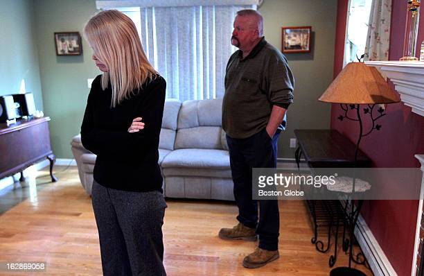 Nervous and apprehensive Lisa and Rick Reckis parents of Samantha Reckis wait in the living room to talk to the media assembled in the kitchen...