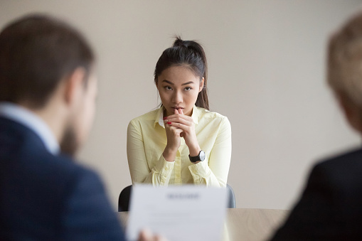 Nervous Asian applicant stressed at job interview 1070079890