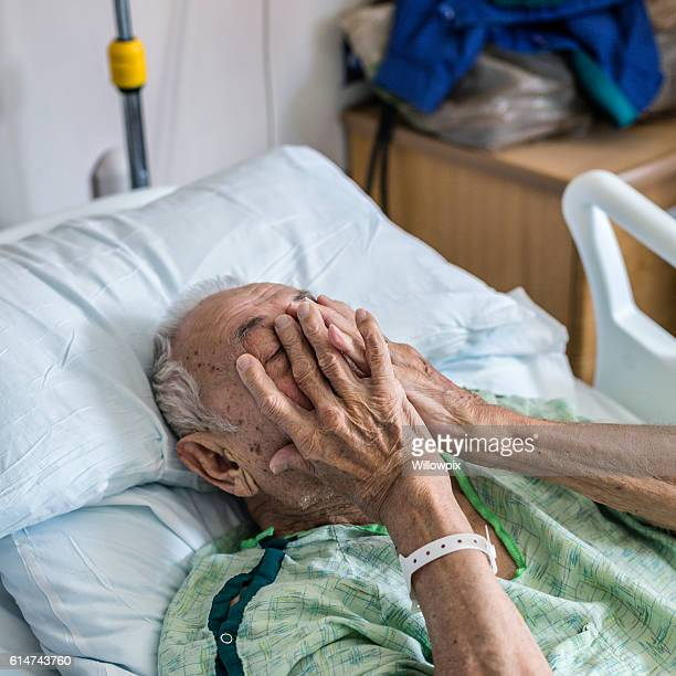 nervous elderly man hospital patient covering face with hands - underweight stock photos and pictures