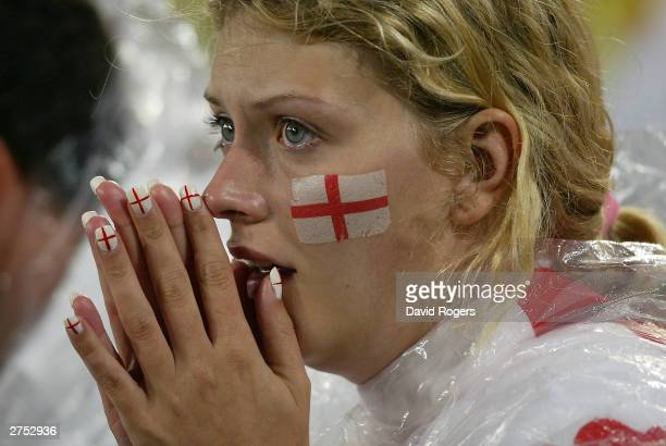 A nervous English fan looks on during extra time during the Rugby World Cup Final match between Australia and England at Telstra Stadium November 22...