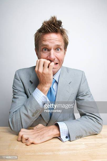 Nervous Office Worker Businessman Biting His Fingernails at Desk