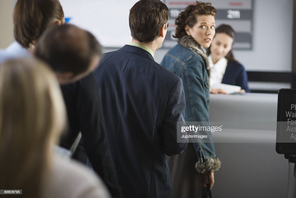 Nervous passenger in line at airport : Stock Photo