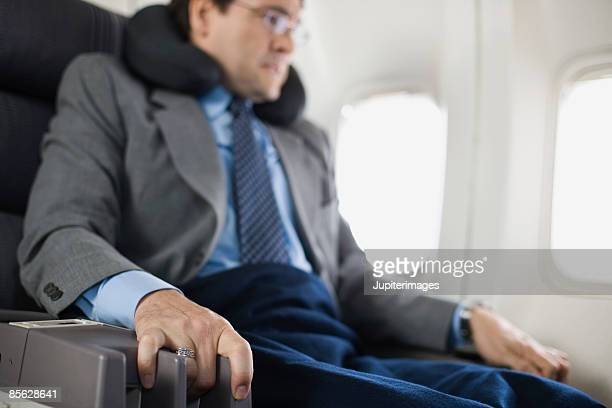 Nervous passenger sitting on airplane