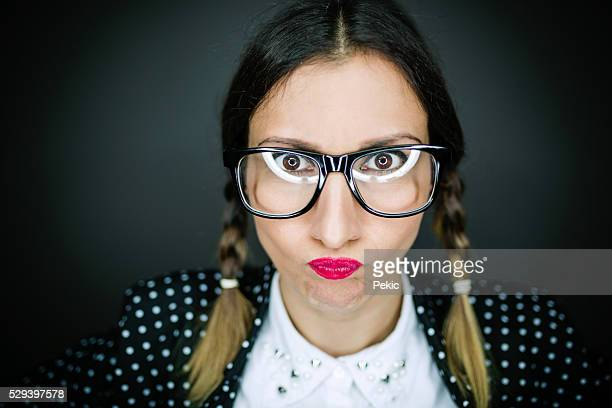 nervous stressed anxious woman with glasses - girl nerd hairstyles stock photos and pictures