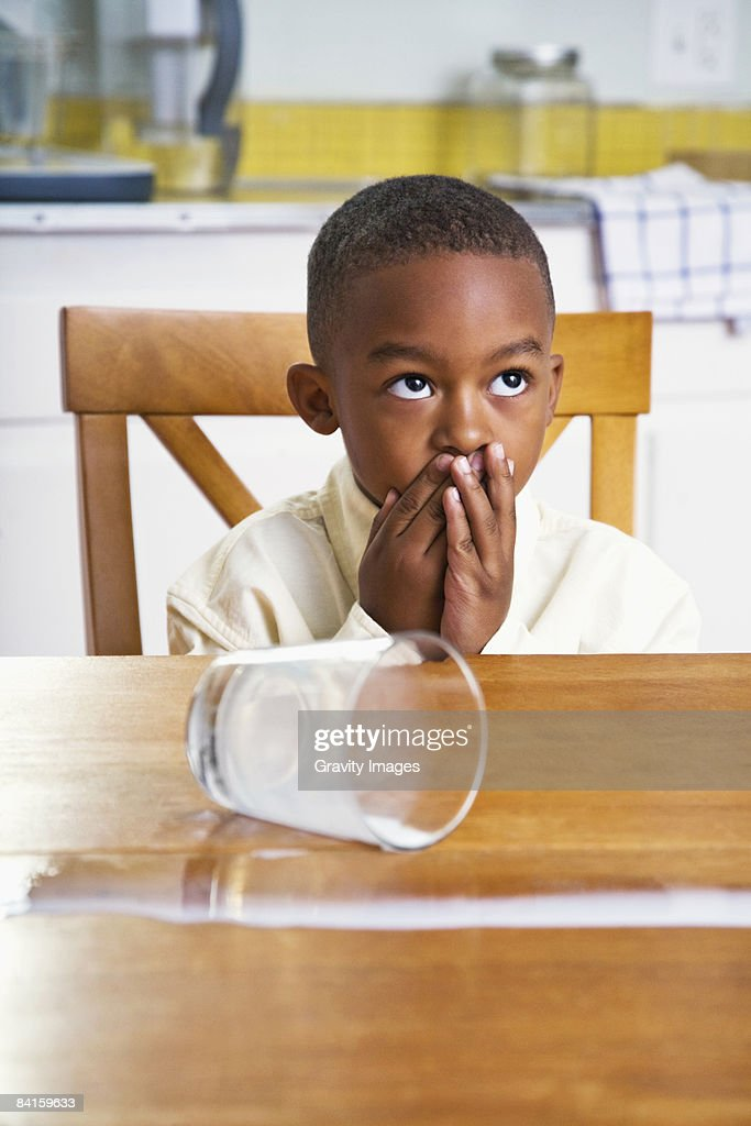 Nervous Young Boy Spilled Milk Stock Photo Getty Images