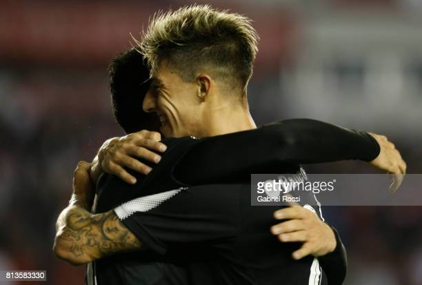 Nery Andres Dominguez of Independiente celebrates with teammate Emiliano Rigoni after scoring the fourth goal of his team during the first leg match...