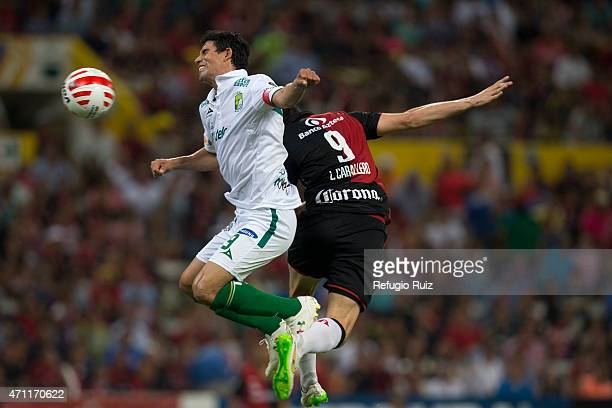 Nery Caballero of Atlas jumps for the ball with Jonny Magallon of Leon during a match between Atlas and Leon as part of 15th round of Clausura 2015...