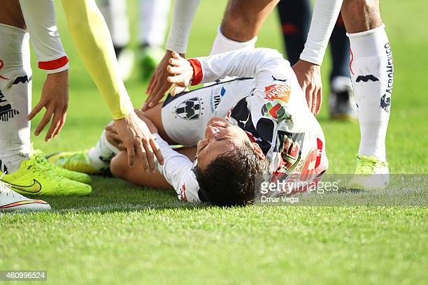 Nery Cardozo of Monterrey lies injured during a friendly match between America and Monterrey at BBVA Compass Stadium on January 03 2015 in Houston...
