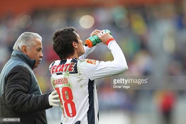 Nery Cardozo of Monterrey prepares to get back in the game after receiving medical attention during a friendly match between America and Monterrey at...