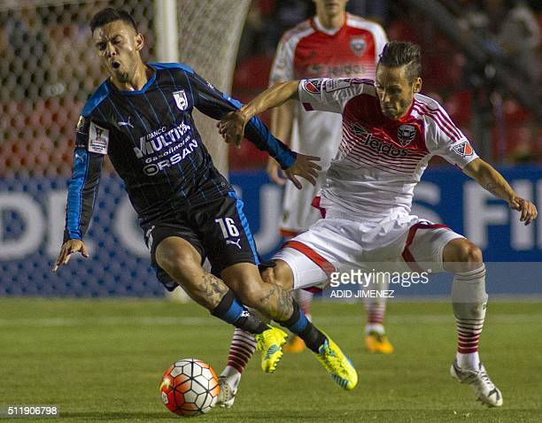 Nery Dominguez of Queretaro vies for the ball with Marcelo Sarvas of DC United during their CONCACAF Champions League quarterfinals football match at...
