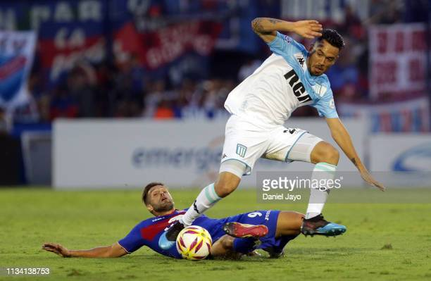 Nery Dominguez of Racing Club and Federico Gonzalez of Tigre fight for the ball during a match between Tigre and Racing Club as part of Superliga...