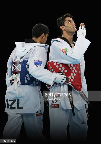 Nesar Ahmad Bahawi of Afghanistan celebrates his win against Vaughn Scott of New Zealand in the Men's 80kg Taekwondo Repechage on Day 14 of the...