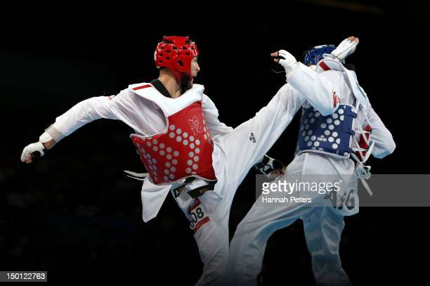 Nesar Ahmad Bahawi of Afghanistan competes against Mauro Sarmiento of Italy in the Men's 80kg Taekwondo Bronze Medal Finals bout on Day 14 of the...